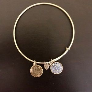 Gold bracelet with blue charms